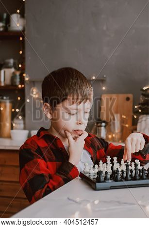 Boy Plays Chess. Favorite Hobby Is Chess. Learn To Play Chess. Development Of Analytical Thinking. C