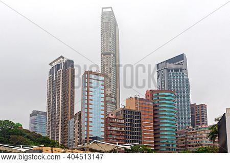 Tall Skyscraper Buildings At Clouds In Kowloon Hong Kong