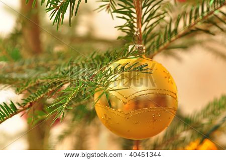 Branch Of New Year Tree With Golden Ball With Bokeh