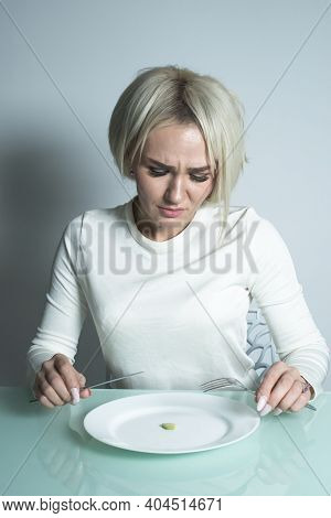 Sick Girl With Anorexia Sits Before Eating.