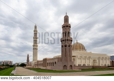 Sultan Qaboos Grand Mosque In Muscat, Oman, Landscape View, With Majestic Marble Walls And Minaret.
