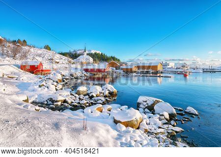 Awesome Winter Scenery Of Moskenes Village With Ferryport And Famous Moskenes Parish Church . Popula