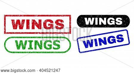 Wings Grunge Seals. Flat Vector Grunge Stamps With Wings Slogan Inside Different Rectangle And Round