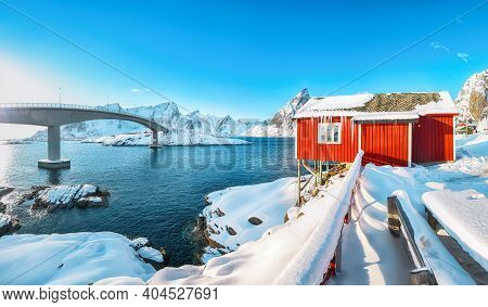 Charming Winter View On Hamnoy Village And Bridge To Olenilsoya Island. Popular Tourist Destination