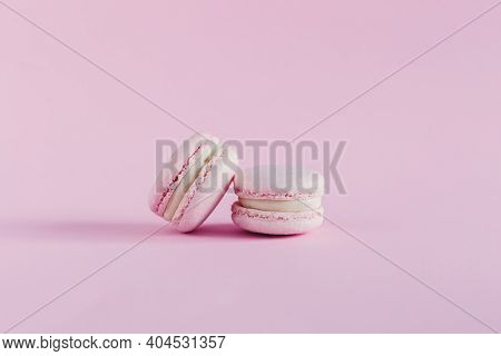 Pink Pastel Macarons On A Pink Pastel Background. Place For Text.