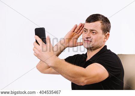 Caucasian Senior Man Talking By Video Call Using Non-verbal Gestures. White Background.