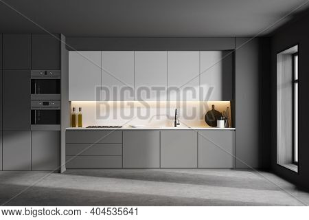 Interior Of Modern Kitchen With Gray And White Walls, Concrete Floor And Grey And White Cupboards Wi