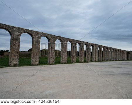 Panorama View Of Historic Old Roman Watercourse Aqueduct Gate Archway Bridge Building In Obidos Port