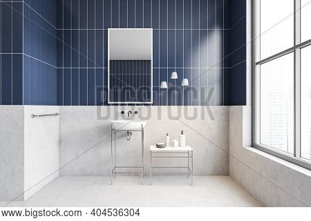 White And Blue Bathroom With Sink, Mirror And Bottles On Table Near Window. Minimalist Light Bathroo