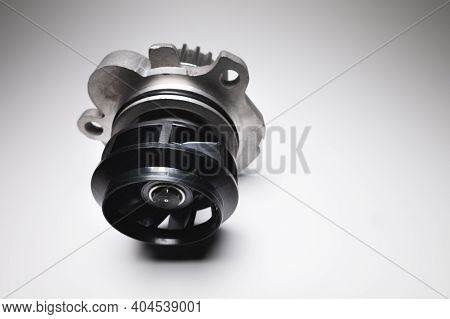 Car Engine Coolant Water Pump New On A Gray Background. Spare Parts