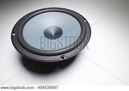 New Car Audio Speaker. One Loudspeaker On Gray Background