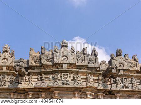 Lakkundi, Karnataka, India - November 6, 2013: Brahma Jinalaya Temple. Intensively Sculpted Gable Of