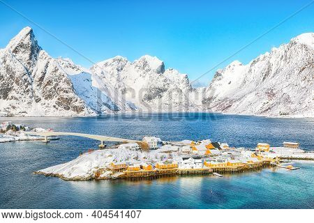 Beathtaking Winter View Of Sakrisoy Village And Snowy Mountaines On Background. Popular Tourist Dest