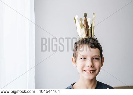 Portrait Of Autism Boy Wearing A Toy Crown. Happy Inclusion And Autism Awareness Concept