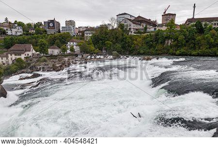 Rhine Falls, Switzerland - May 6, 2017: The Rhine Falls Landscape At Cloudy Day
