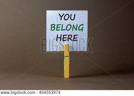 You Belong Here Symbol. Wooden Clothespin With White Paper. Words 'you Belong Here'. Beautiful Grey