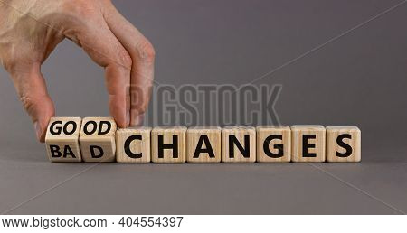 Bad Or Good Changes Symbol. Businessman Turns Wooden Cubes And Changes Words 'bad Changes' To 'good