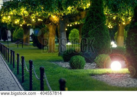Ground Garden Light Glare With Lantern Electric Lamp With A Round Diffuser In The Green Grass With T