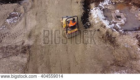 Soil Preparation Before Construction Of The Object. Special Equipment In The Press Soil Before Pouri