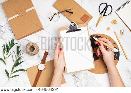 Desktop With Woman Hands Holding Clipboard And Recyclable Office Supplies. Home Office, Social Media