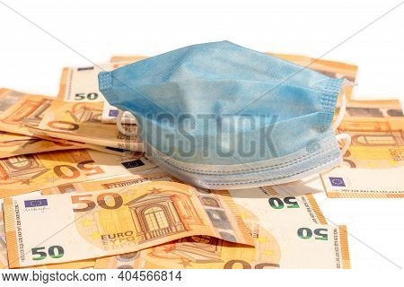 Medical Face Masks And Fity Euro Banknote Money. Surgical Face Mask. Covid-19 Has Caused A Shortage