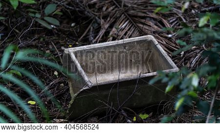An Old Concrete Rectangular Object Discarded In Bushland