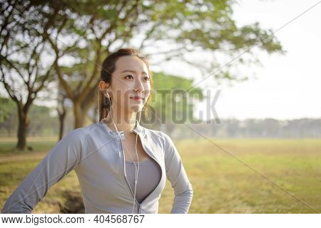 Closeup Beautiful Young Woman Face Before Running In The Park At  Morning