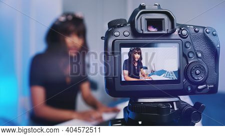 Young Woman Influencer Recording New Video Tutorial On Her Dslr. High Quality Photo