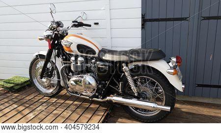 Bordeaux , Aquitaine  France - 01 18 2021 : Triumph Bonneville T100 Motorcycle Vintage Style Parked