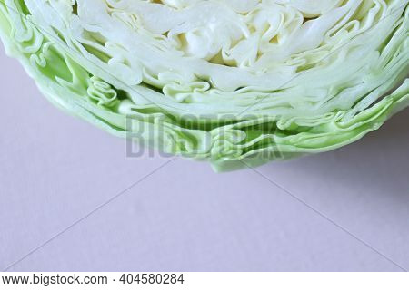 Texture Of Sliced Cabbage. Cabbage And Lilac Background. Cabbage. Sliced Cabbage.