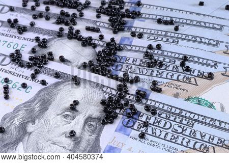 A Lot Of One Hundred Dollar Bills. The Concept Of Crisis And Dollars. Dollars And Beads. One Hundred