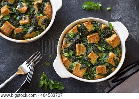 Baked Green Omelet With Spinach And Croutons, In White Form On Dark Textured Background, Flat Lay