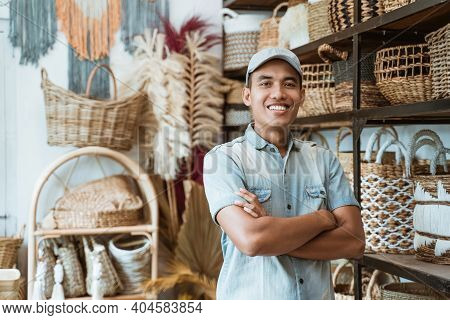 Owner A Craft Business With Crossed Hands While In A Craft Shop