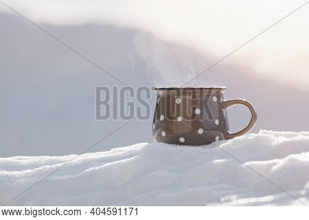 Cup Of Hot Tea In The Fresh Snow, Winter Background