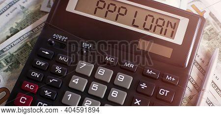 Calculator With Text Ppp Loan On Dollars. Business, Finance Conceptual.