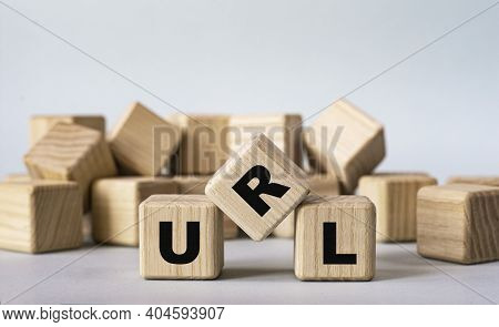 Url (uniform Resource Locator) - Acronym On Wooden Cubes On A Light Background. Business Concept
