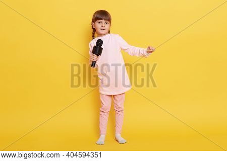Little European Girl Singing With Microphone, Looks At Camera, Singing In Karaoke, Performing, Makin