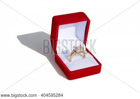 Valentines Day. Wedding Ring with a Red Valentines Day Heart. Engagement Ring in a Red Ring Box. Isolated on white. Room for text. Happy Valentines Day. Be My Valentine.
