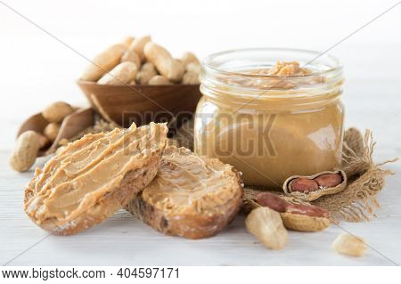 Fresh peanut butter on white background, close-up