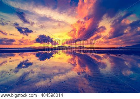 Thailand sunrise silhouette aerial: ocean gulf waterfront with sky reflection. Asian island scenic sun rise with boat on water surface. Amazing nobody nature landscape in cinematic sort shot
