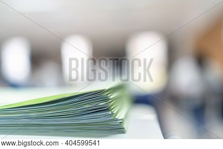 Exam Answer Sheet Pile, Blurry Application Document Paperwork Stack On Office Work Table In Examinat