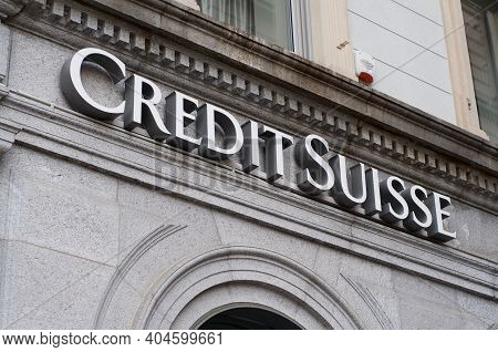 Lugano, Switzerland - 12th January 2021 : Credit Suisse Bank Sign Hanging On An Old Building Facade