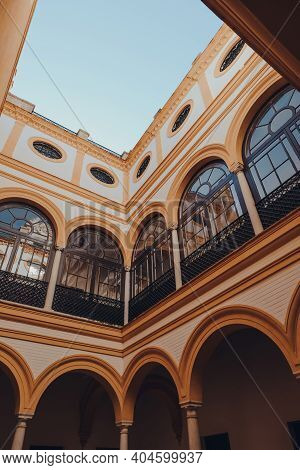 Seville, Spain - January 19, 2020: Low Angle View Of The Colourful Courtyard Of The Hiring House Of