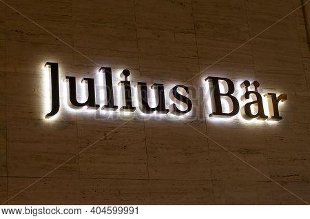 Lugano, Ticino, Switzerland - 14th January 2021 : Luminous Julius Baer Bank Sign Hanging On A Buildi