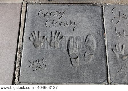 Los Angeles, Usa - July 10, 2017: Handprints At Hollywood Boulevard In Los Angeles. There Are Nearly