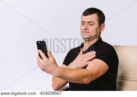 Senior Hard Of Hearing Man Communicates Via Video Call Using Non-verbal Gestures. White Background.