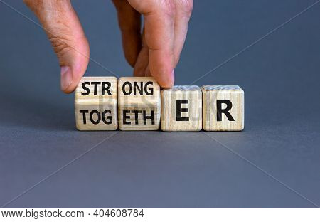 Stronger Together Symbol. Businessman Turns Cubes And Changes The Word Together To Stronger. Beautif