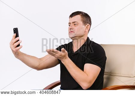 Caucasian Surdomute Man Communicates Non-verbal Via Video Call By Stretching Out His Thick Palm Towa