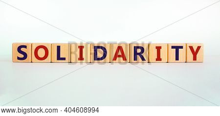 Time To Solidarity Symbol. Concept Word Solidarity On Wooden Cubes On A Beautiful White Background.
