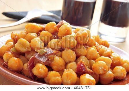closeup of a plate with spanish garbanzos con jamon, chickpeas with serrano ham, served as tapas